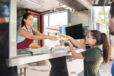 Woman serving food to customer