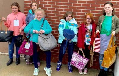 Girl Scouts donate purses