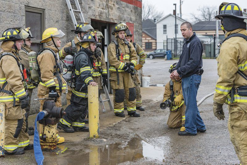 Firefighting class works on ladder, forcible entry training