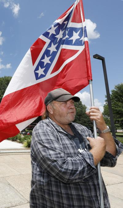 Mississippi surrenders Confederate symbol from flag