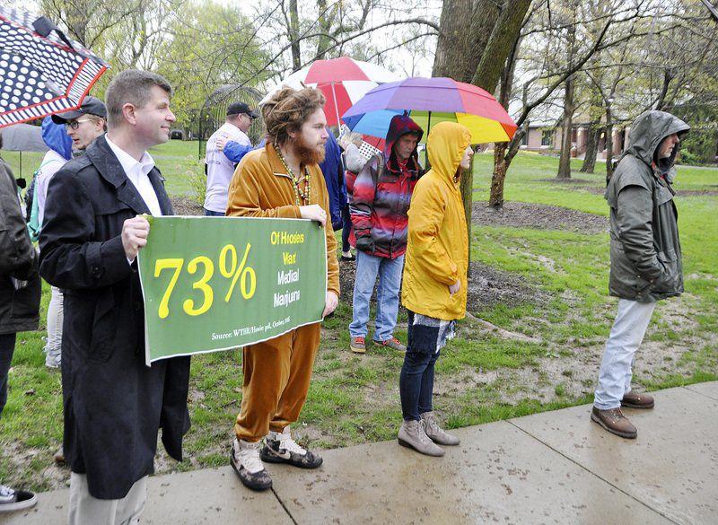 Marijuana backers rally at Governor's mansion
