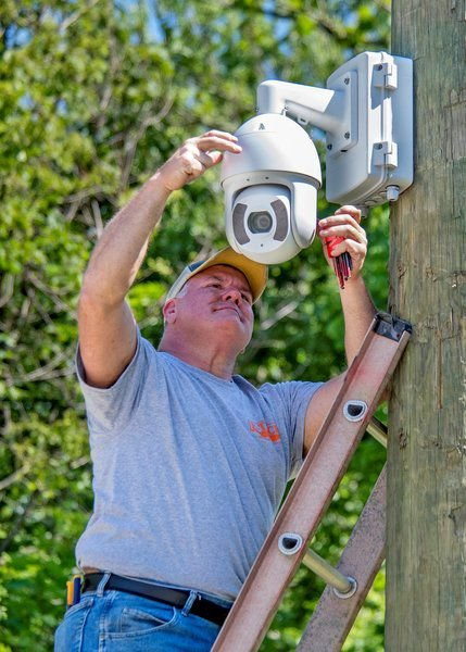 Workers are installing new trail cams on the city's walking trails