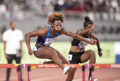 Nia Ali leads 100m Women's Hurdles on May 10, 2019 at the World Athletics Championships in Doha, Qatar.  — Photo by: Anke Waelischmiller/SVEN SIMON/picture-alliance/dpa/AP Images