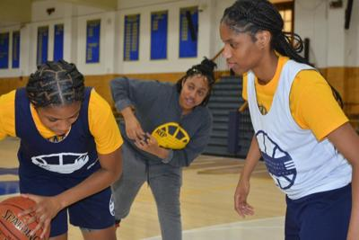 West Catholic High School co-captains Destiney McPhaul (left) and Tamiah Robinson are pictured at practice with head coach Beulah Oseuke. — TRIBUNE PHOTO/SAMARIA BAILEY