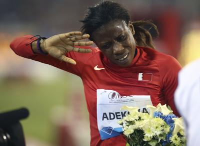 In this May 9, 2014 file photo, Kemi Adekoya of Bahrain gestures after winning the 400m hurdles at the IAAF Diamond League in the Qatari capital Doha. Adekoya has been banned for doping in the latest drug case to hit Bahrain's stable of elite African-born runners, it was announced Friday. The Athletics Integrity Unit, which oversees doping cases in track and field, says Adekoya tested positive for the banned steroid stanozolol. — AP Photo/Osama Faisal, File