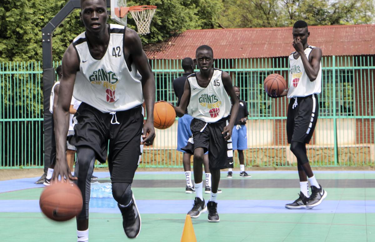 Players dribble during a three-day basketball training camp run by Giants of Africa in Juba, South Sudan. Masai Ujiri, president of the Toronto Raptors basketball team who won the NBA championship for the first time this year, is founder of the Giants of Africa non-profit organization which runs a three-day training camp in South Sudan to empower youth through basketball. — AP Photo/Sam Mednick