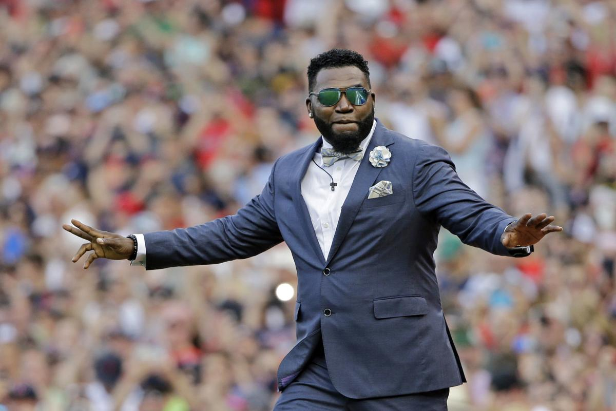 """In this June 23, 2017, file photo, Boston Red Sox baseball great David Ortiz waves to fans at Fenway Park in Boston as the team retires his number """"34"""" worn when he led the franchise to three World Series titles. — AP Photo/Elise Amendola, File"""