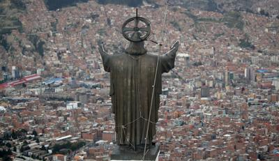 A Christ statue overlooks El Alto, a city adjoining the capital city La Paz, Bolivia. Ancestral indigenous practices became more visible during the presidency of Evo Morales, who recognized the Andean earth deity Pachamama. While Bolivians are divided on former President Morales' legacy, the interim President Jeanine Añez wants to make the Bible front and center in public life. — AP Photo/Natacha Pisarenko