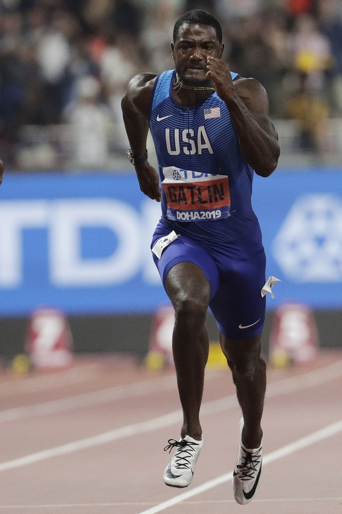 In this Sept. 28, 2019, file photo, Justin Gatlin competes enroute to a silver medal in the 100m dash at the World Athletics Championships in Doha, Qatar. Gatlin will be 39 by the time the games roll around, and Jamaican Asafa Powell is just nine months younger. They are both ancient in this young sprinter's game. They still think they can give the younger generation a run for their money. — AP Photo/Petr David Josek, File