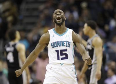 "Charlotte Hornets' Kemba Walker , a three-time All-Star point guard, says he'd be willing to work with the Hornets and take less than the ""supermax"" $221 million contract he's eligible to receive to re-sign with Charlotte. — AP Photo/Chuck Burton, File"