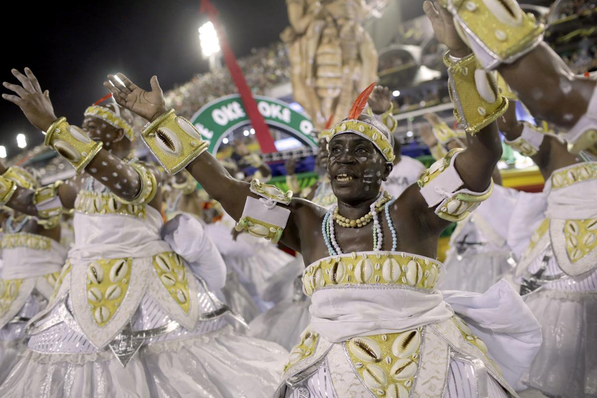 Performers from the Grande Rio samba school parade during Carnival celebrations at the Sambadrome in Rio de Janeiro, Brazil. — AP Photo/Silvia Izquierdo