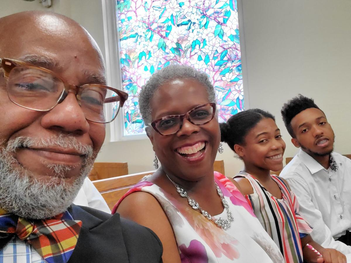FAMILY PORTRAIT  Sitting from left, the Rev. Michael Robinson, first lady Dana Robinson, daughter Joy Robinson and son Matthew Robinson of Greater Enon Missionary Baptist Church. — SUBMITTED PHOTO