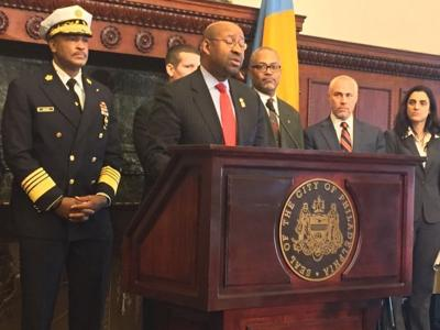 mayor michael nutter, at podium, announces new contract with international association of firefighters local 22