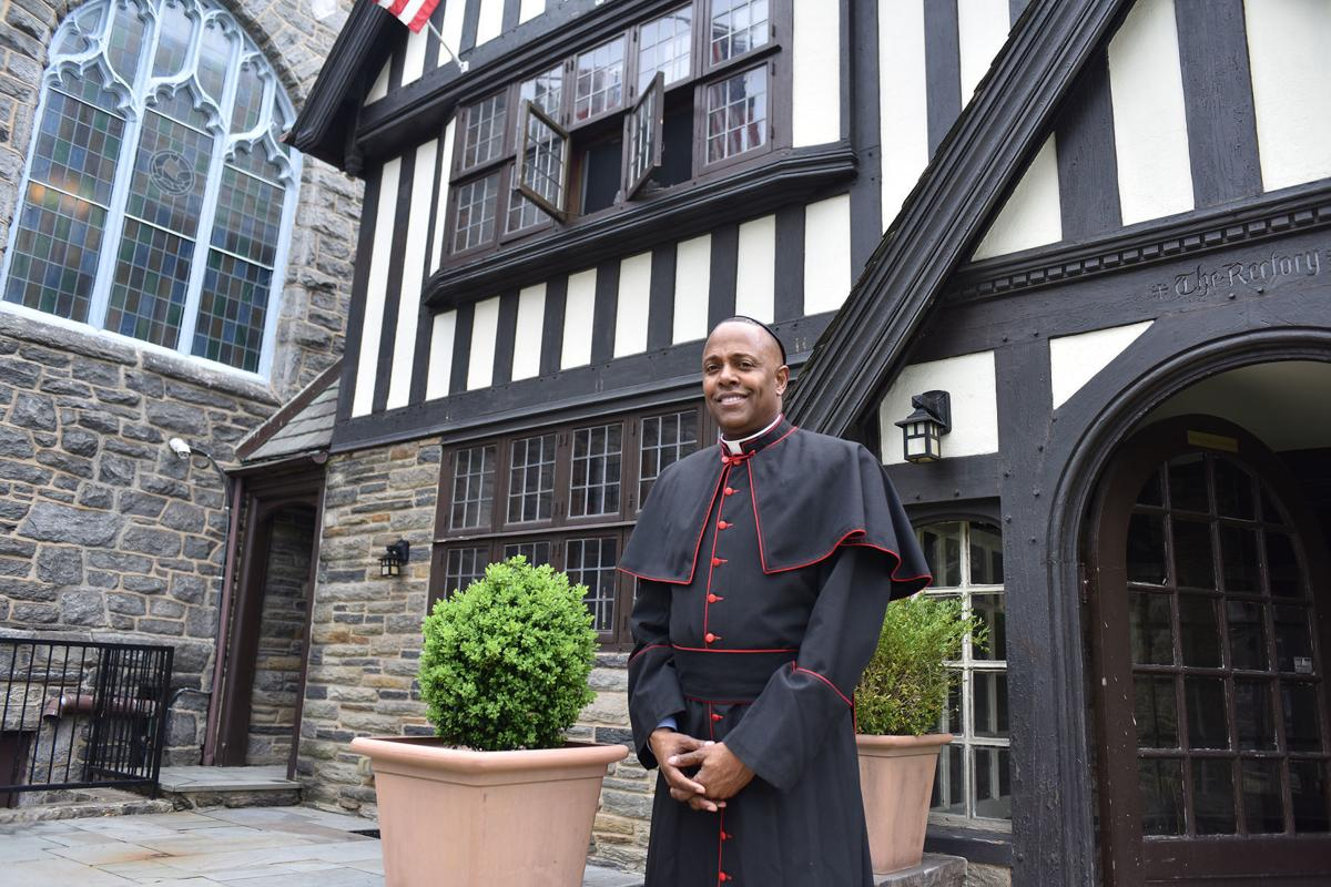 The Very Rev. Canon Martini Shaw stands outside of the African Episcopal Church of St. Thomas. PHOTO BY ABDUL R. SULAYMAN/ TRIBUNE CHIEF PHOTOGRAPHER