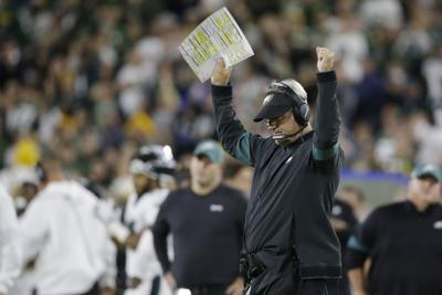Philadelphia Eagles coach Doug Pederson celebrates after a replay ruling on the field confirmed a touchdown for the Eagles during the first half of an NFL game against the Green Bay Packers on Sept. 26 in Green Bay, Wisconsin. — AP Photo/Jeffrey Phelps