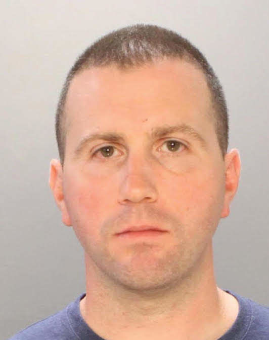 Former cop gets murder charge reduced