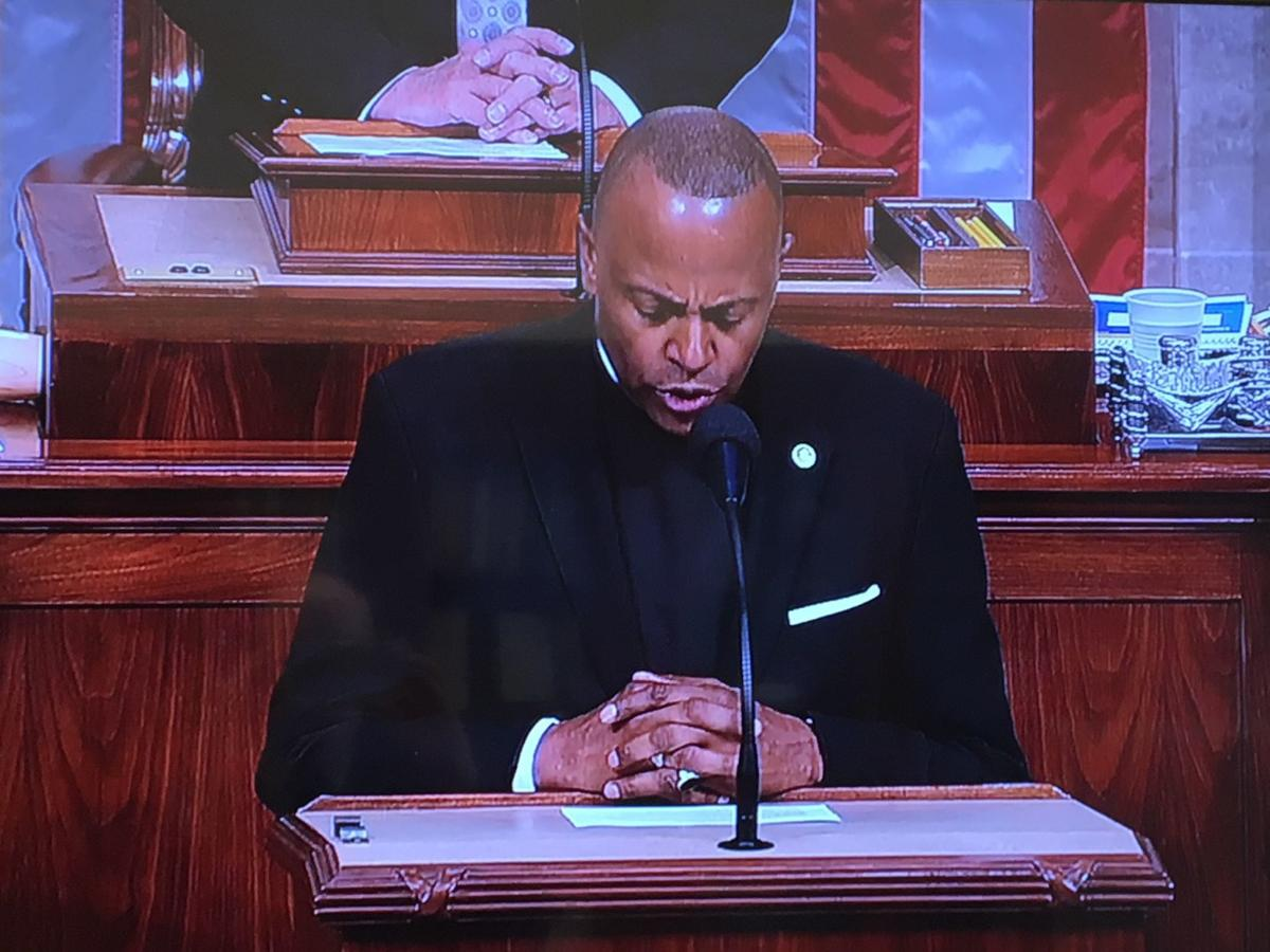 The Very Rev. Canon Martini Shaw of the African Episcopal Church of St. Thomas prays in before the U.S. House of Representatives on Thursday. U.S. Rep. Dwight Evans (PA-03) hosted Shaw, who served guest chaplain. — SUBMITTED PHOTOS