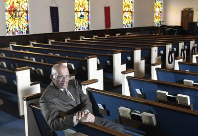 "The Rev. Alvin J. Gwynn Sr., of Friendship Baptist Church in Baltimore, sits in his church's sanctuary. He bucked the cancellation trend by holding services the previous Sunday. But attendance was down by about 50%, and Gwynn said the day's offering netted about $5,000 compared to a normal intake of about $15,000. ""It cuts into our ministry,"" he said. ""If this keeps up, we can't fund all our outreach to help other people."" — AP Photo/Steve Ruark"
