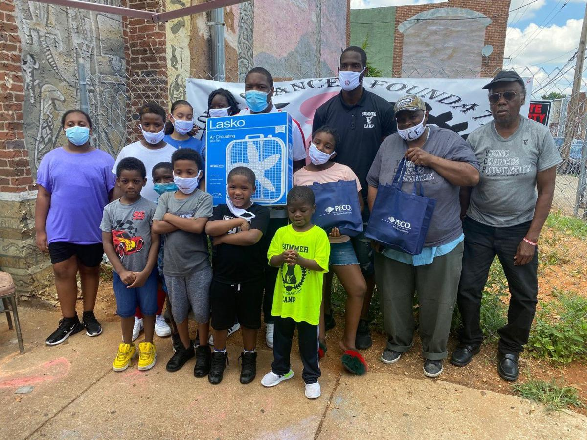 City Councilman Kenyatta Johnson and Tyrique Glagow, executive director of the Young Chances Foundation presented families in South Philadelphia with fans