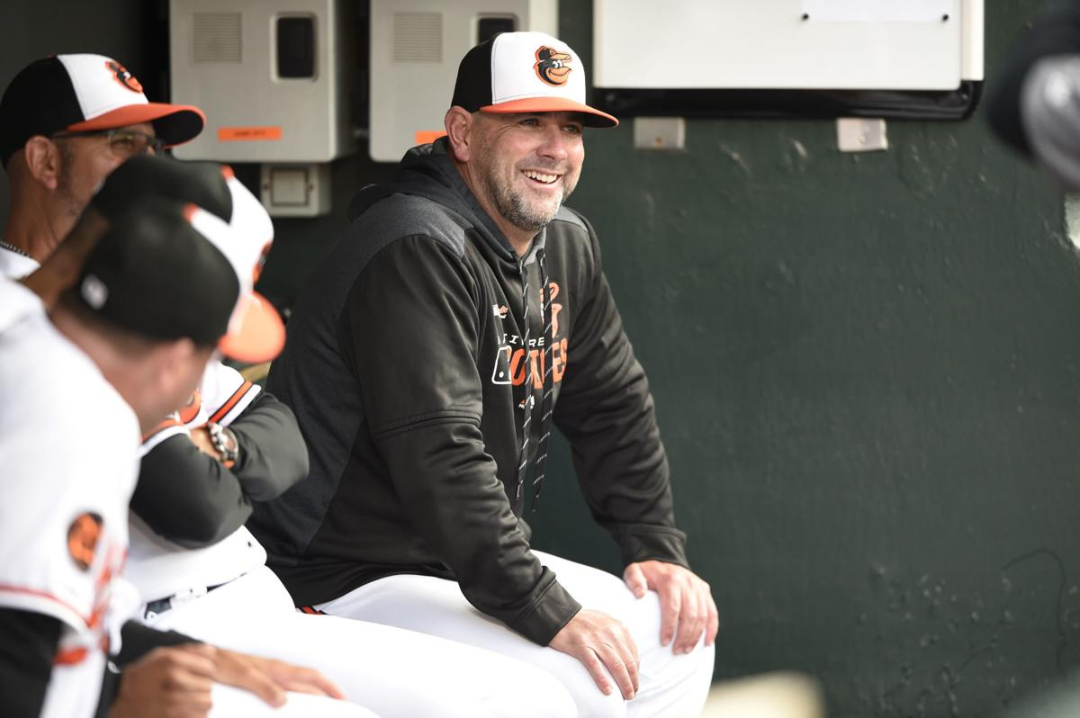 In this April 9 file photo, Baltimore Orioles manager Brandon Hyde sits in the dugout before playing the Oakland Athletics in a baseball game in Baltimore. There might come a time when Hyde wakes up in the morning, grabs a newspaper and checks out the standings to see where the Orioles stand. For now, the rookie manager simply can't bear to look. The rebuilding Orioles limped into the All-Star break with a major league worst 27-62 record. — AP Photo/Gail Burton, File