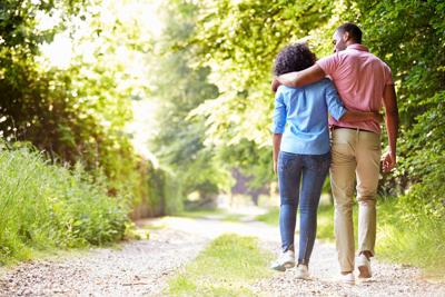Young,African,American,Couple,Walking,In,Countryside