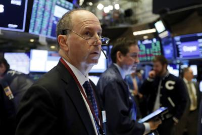 Trader Gordon Charlop works on the floor of the New York Stock Exchange. — AP Photo/Richard Drew, File