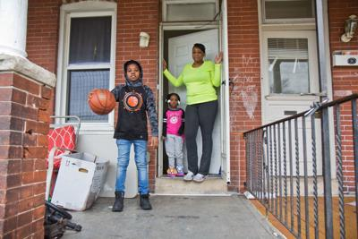 Norristown resident Lakeyia Johnson just re-entered the workforce after a serious illness, but school closing due to COVID-19 are keeping her children and Johnson home. — WHYY Photo/Kimberly Paynter