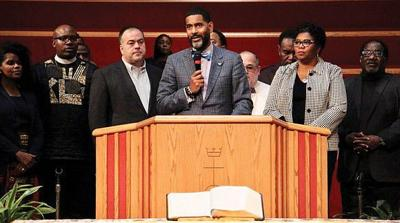 The Rev. Otis Moss III, center, is surrounded by other Chicago church leaders and denomination officials with the United Church of Christ to announce on Oct. 20 that the group paid off $5.3 million in medical debt for poor people in Illinois. — EMILY MCFARLAN MILLER/RELIGION NEWS SERVICE