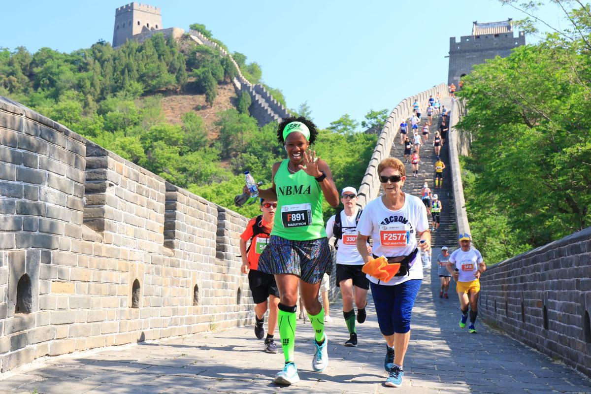 Lisa Davis runs on the Great Wall of China