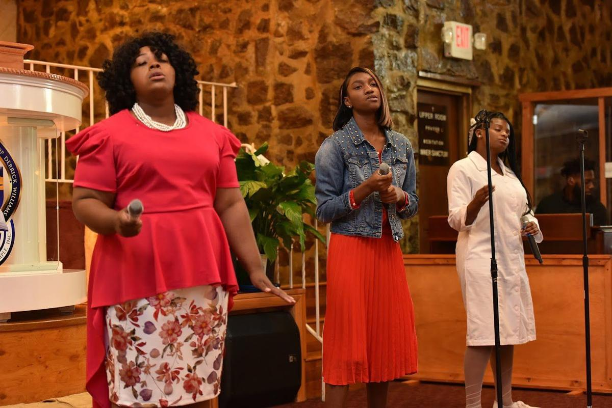 The Praise and Worship Team sings a selection.