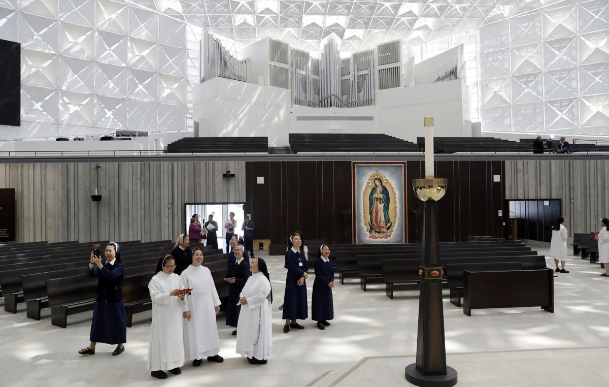 Nuns get a first look at the newly renovated Christ Cathedral in Garden Grove, California. The 88,000-square-foot Catholic church has undergone a $77 million renovation. — AP Photo/Marcio Jose Sanchez