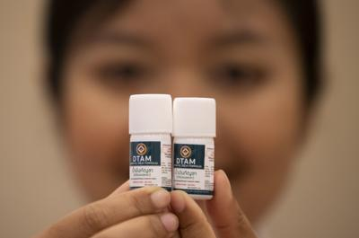 A doctor show containers of cannabis oil at the first full-time clinic prescribing cannabis oil for medical treatment in the Public Health Ministry in Nonthaburi province, Thailand. The opening of the clinic is another step forward in the government's policy of promoting the licensed medical use of marijuana products to relieve the symptoms of a range of conditions. — AP Photo/Sakchai Lalit