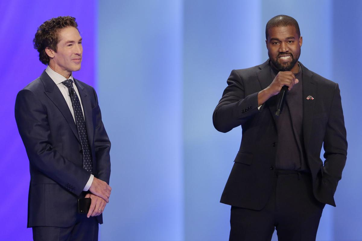 Rapper Kanye West, right, answers questions from Joel Osteen, left, during a service at Lakewood Church, Sunday in Houston. — AP Photo/Michael Wyke