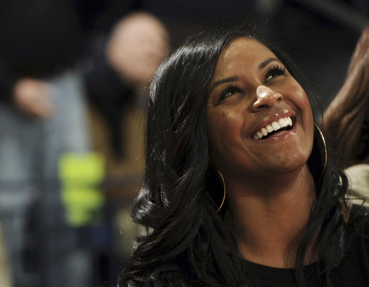 In this Nov. 17, 2011, file photo, Notre Dame assistant coach Niele Ivey smiles during a presentation prior to a college basketball game against Hartford in South Bend. Ind. The Memphis Grizzlies announced Monday, that they have hired Ivey among the new assistants for coach Taylor Jenkins. — AP Photo/Joe Raymond, File