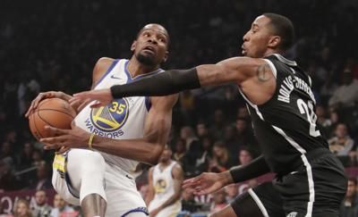In this Oct. 28, 2018, file photo, Brooklyn Nets' Caris LeVert (22) defends against Golden State Warriors' Kevin Durant.  — AP Photo/Frank Franklin II, File