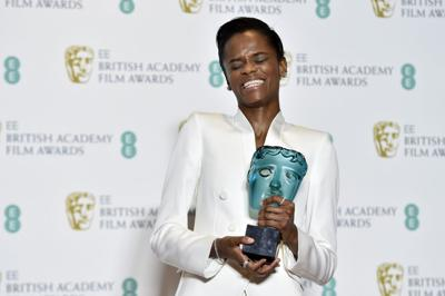Letitia Wright poses with her Rising Star award in the press room during the 72nd annual British Academy Film Awards