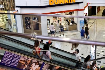Photo shoppers ride an escalator inside the Glendale Galleria in Glendale, California. If a threat of a recession gives you pause when it comes to your personal finances, remember now is a time to prepare, not panic. Financial experts say there a steps you can take now to brace yourself for any downturn ahead. — AP Photo/Richard Vogel