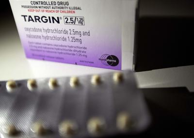 A pack of Targin opioid pills made by Mundipharma is photographed in Sydney, Australia. Australia's drug regulator has fined a pharmaceutical company owned by the billionaire Sackler family over what it dubbed misleading advertising for one of its opioid painkillers, as the country grapples with surging rates of opioid prescriptions and related deaths. Mundipharma Australia, the international affiliate of OxyContin maker Purdue Pharma, was ordered to pay penalties of 302,400 Australian dollars ($209,000) by the Therapeutic Goods Administration over its promotion of the opioid Targin, the drug regulator said in a statement. — AP Photo/David Goldman, File