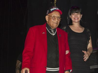 In this Sept. 11, 2013 file photo, actress Pauley Perrette, right, and Lt. Col. Bob Friend, a Tuskegee Airman, stand onstage during the 2nd Annual Heroes Helping Heroes Benefit Concert at The House of Blues in Los Angeles. World War II pilot Friend, one of the last original members of the famed all-Black Tuskegee Airmen, has died at the age of 99. Friend's daughter, Karen Friend Crumlich, told The Desert Sun her father died on Friday, June 21, 2019, at a Southern California hospital. — Photo by Paul A. Hebert/Invision/AP, File