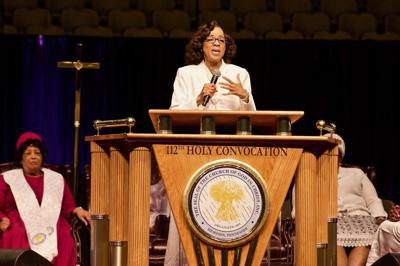 Joyce Rodgers, assistant supervisor, COGIC International Women's Department, spoke at Women's Day on Nov. 8 at America's Center, part of the Church of God in Christ's (COGIC) 112th Holy Convocation in St. Louis, Missouri. Seated behind her is Mother Barbara McCoo Lewis, general supervisor, COGIC International Women's Department. — PHOTO TAKEN BY WILEY PRICE OF THE ST. LOUIS AMERICAN