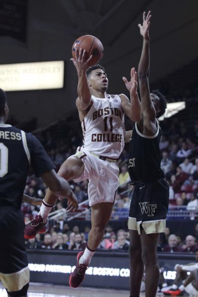 Boston College guard Derryck Thornton (11) drives to the basket against Wake Forest during the second half of an NCAA basketball game in Boston on Wednesday. Thornton scored 23 points in Boston College's 77-70 win. — AP Photo/Charles Krupa