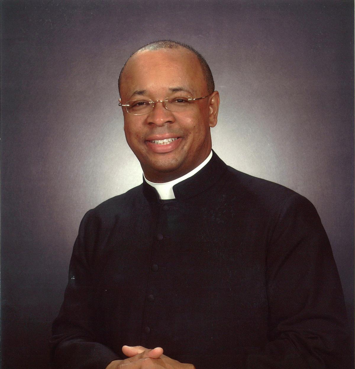 Black priest gets top honor from Catholic school ...