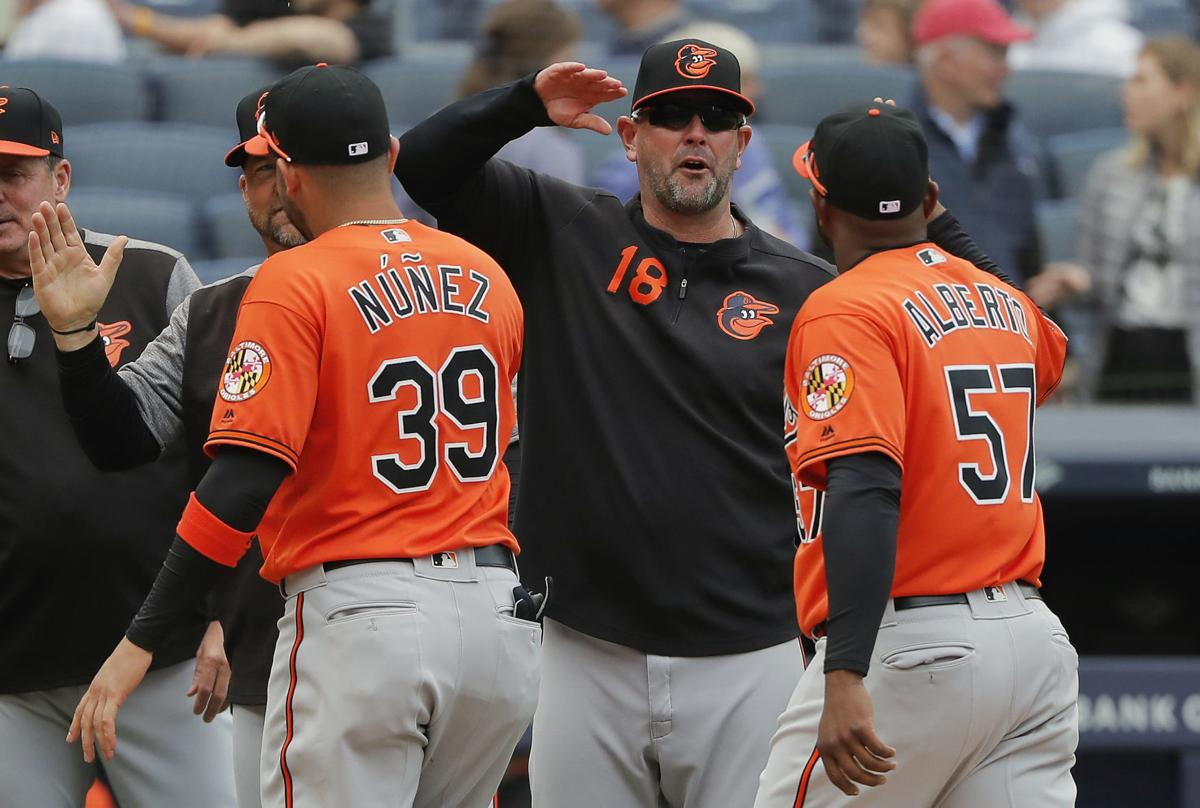 In this March 30 file photo,Baltimore Orioles manager Brandon Hyde (18) congratulates players after they defeated the New York Yankees in a game in New York. The win was Hyde's first as a major league manager. — AP Photo/Julie Jacobson, File