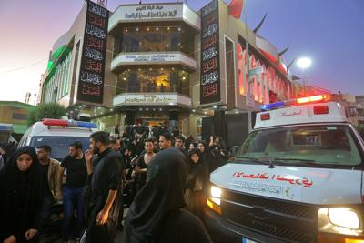 People gather outside a hospital while ambulances bring injured people after a walkway collapsed and set off a stampede as thousands of Shiite Muslims marked one of the most solemn holy days of the year in the holy city of Karbala, Iraq on Tuesday. Officials said at least 31 people have died and around 100 others were injured in the chaos Tuesday, which occurred toward the end of the Ashoura procession, causing panic and a stampede, according to two officials. — AP Photo/Anmar Khalil