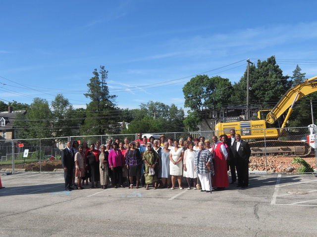 Grace Baptist Church members in front of the demolition site.