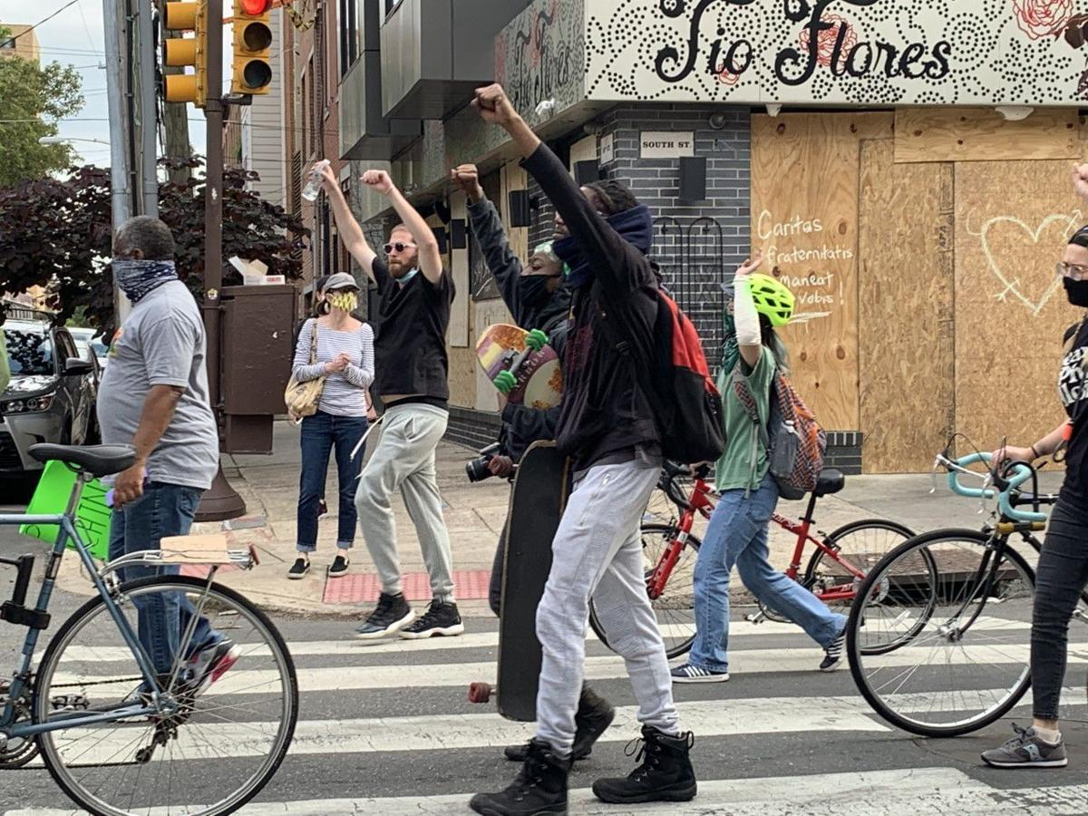 Protesters walk down South Street
