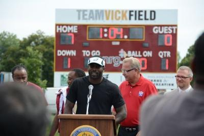 Vick helps bring new field to North Phila.