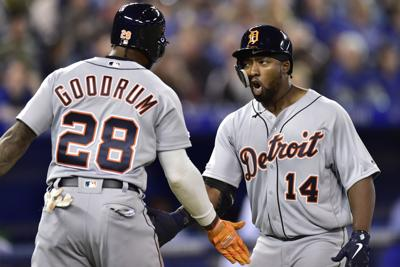 Detroit Tigers' Christin Stewart (14) celebrates his two-run home run with Niko Goodrum (28) during the 10th inning against the Toronto Blue Jays in Toronto on Thursday. — Frank Gunn/The Canadian Press via AP