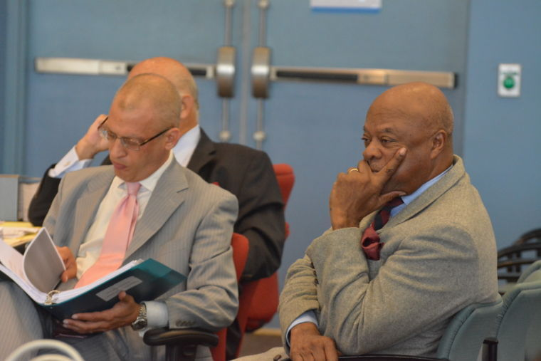 Palmer defends record at public hearing