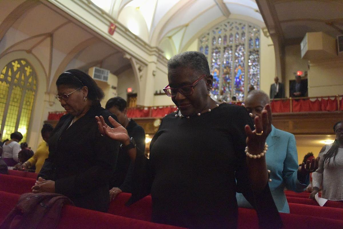 The congregation bow their heads for prayer. — TRIBUNE PHOTOS BY RONALD GRAY